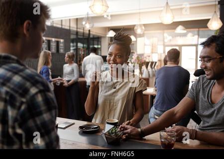 African woman entrepreneur having meeting in a coffee shop