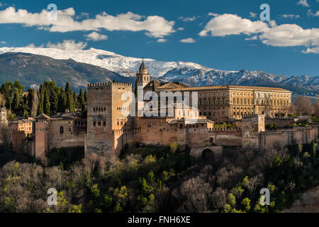 Alhambra palace with the snowy Sierra Nevada in the background, Granada, Andalusia, Spain - Stock Photo