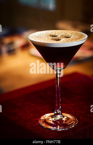 espresso coffee martini cocktail drink in bar at night - Stock Photo