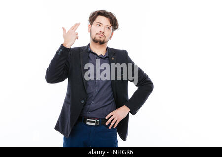 Businessman making suicide gesture isolated on a white background - Stock Photo