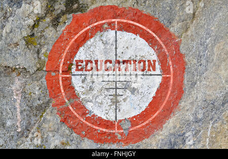 Single word Education in the center of a red circle on textured background - Stock Photo