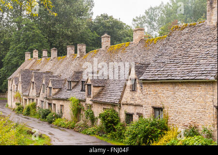 The row of 14th Century cottages are Arlington Row in Bibury , Gloucestershire , England , Britain , Uk - Stock Photo