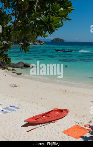 Red Kayak On Sunrise Beach, Ko Lipe, Thailand - Stock Photo