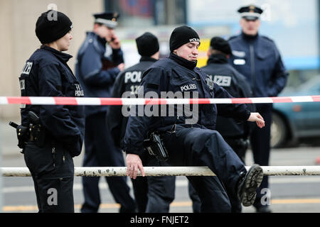 Berlin, Germany. 15th Mar, 2016. Police officers stand guard near the site of the car explosion in Berlin, Germany, - Stock Photo