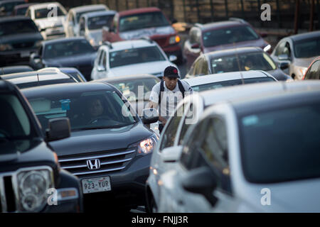 Mexico City, Mexico. 15th Mar, 2016. A cyclist moves through heavy traffic in Mexico City, capital of Mexico, on - Stock Photo