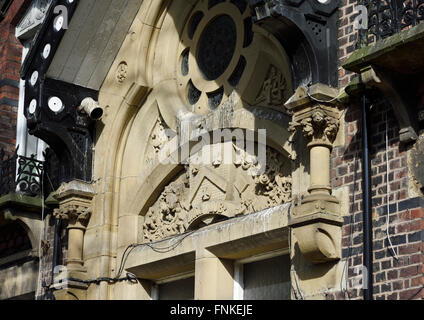 Ornamental stonework stained by pigeon droppings in bury lancashire - Stock Photo