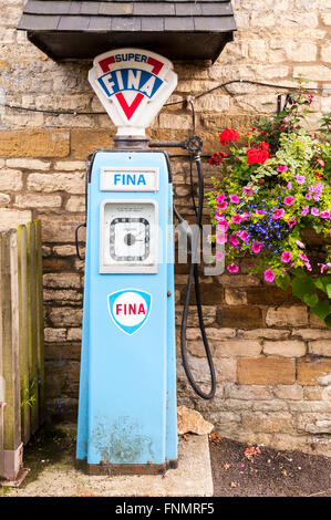 An old fashioned petrol pump in the Uk - Stock Photo