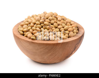 Soybeans in wooden bowl isolated on white - Stock Photo