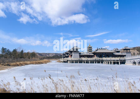 Chinese style antique imitation buildings in the center of the lake - Stock Photo