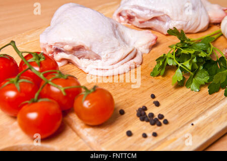 ... Raw Chicken Legs With Vegetables And Spices On A Cutting Board   Stock  Photo
