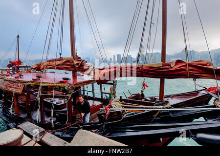 Hong Kong, China - January 31, 2016: A Traditional Chinese Junk boat is about to dock at Victoria Harbor in Hong - Stock Photo