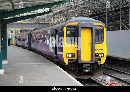Class 156 diesel multiple unit in Northern rail livery waiting to set off on a passenger service to Newcastle Central. - Stock Photo