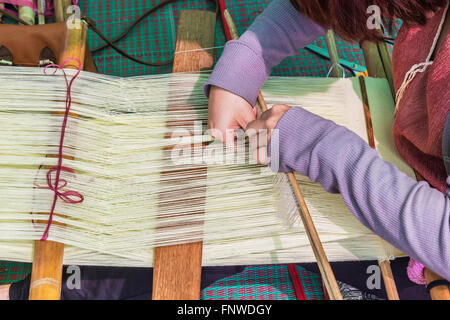 Close up shot Hands of a woman was weaving, Selective focus on hand - Stock Photo