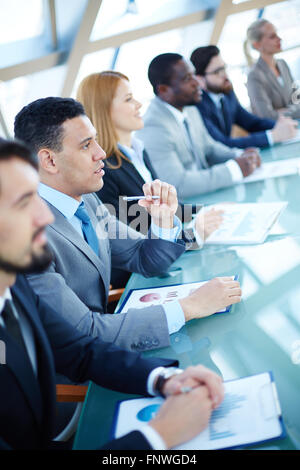 Businessman and his colleagues attending business seminar - Stock Photo