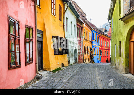 Sighisoara, Romania. Stone paved old streets with colorful houses in Sighisoara fortress, Transylvania region of - Stock Photo