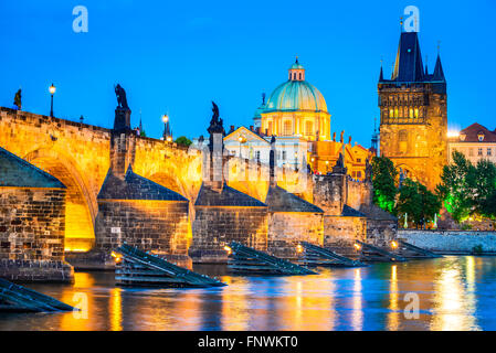 Prague, Czech Republic. Night view with Vltava River, Charles Bridge and Stare Mesto Old Town Tower. Twilight image - Stock Photo