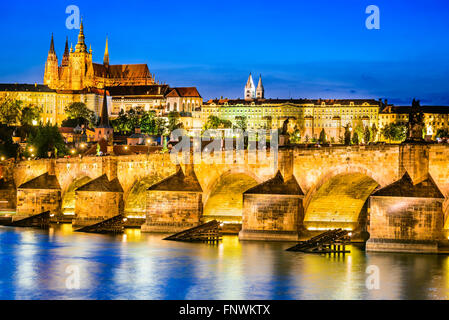 Prague, Czech Republic. Charles Bridge and Hradcany (Prague Castle) with St. Vitus Cathedral and St. George church evening dusk, Stock Photo