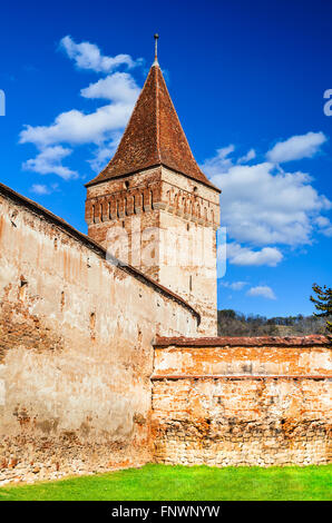 Mosna, Transylvania. Dungeon tower of Mosna fortified church. one of the most beautiful and biggest churches in - Stock Photo