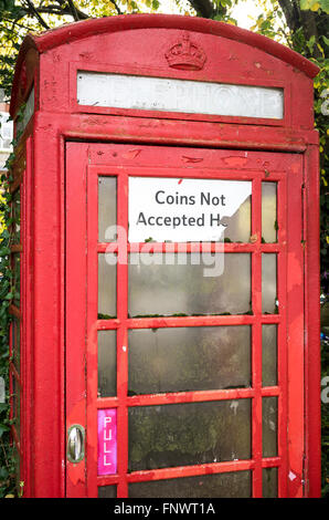 Old surviving Post Office telephone box now converted to coinless operation in a rural village - Stock Photo