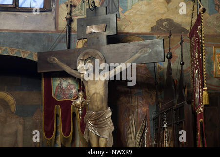 Crucifix in the Dormition Church at the Olsany Cemetery in Prague, Czech Republic. The Dormition Church designed - Stock Photo