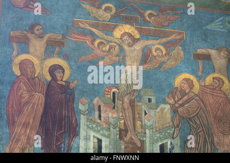 The Crucifixion. Mural painting by Russian icon painter Ilya Shapov (1912-1989) in the Dormition Church at the Olsany - Stock Photo