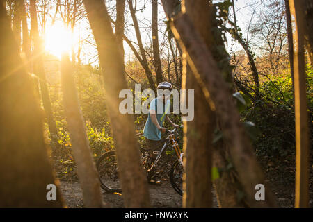 Boy riding Mountain Bike in Italy during an autumnal day. 2015. - Stock Photo