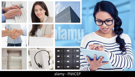 Composite image of attractive asian woman using tablet - Stock Photo