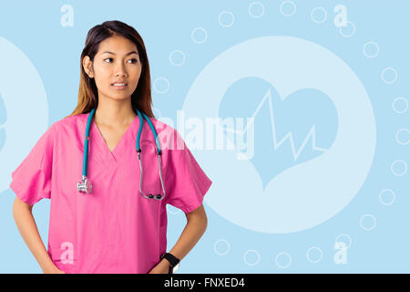 Composite image of asian nurse with stethoscope looking at the camera - Stock Photo