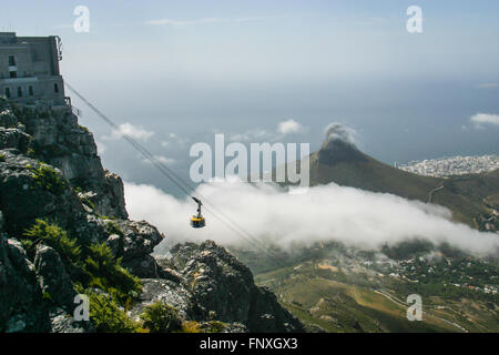 Cable car ascends to the top of Table Mountain in Cape Town, South Africa - Stock Photo