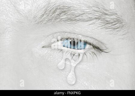 Crying blue left eye - Stock Photo