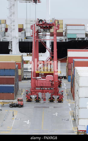Cargo Ship And Containers At Port Area Stock Photo