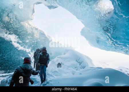 People at the entrance of an ice cave, Vatnajökull Nationalpark, Glacier, Iceland
