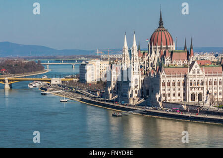 Budapest, Hungary - March 14, 2016: Tourists in front of the Parliament building in Budapest, Hungary - Stock Photo