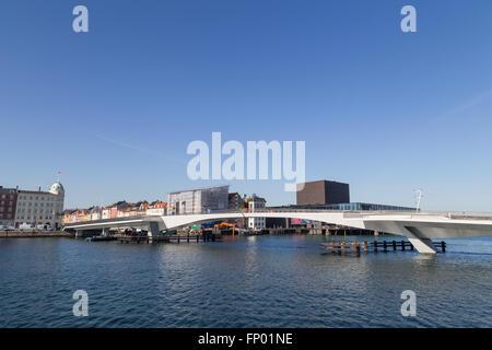 Copenhagen, Denmark - March 16, 2016: Inner Harbour pedestrian and cyclist bridge connecting Nyhavn and Christianshavn. - Stock Photo