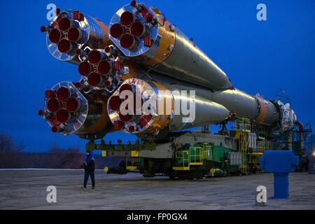 Baikonur, Kazakhstan. 16th Mar, 2016. The Soyuz TMA-20M spacecraft is rolled out to the launch pad by train at the - Stock Photo