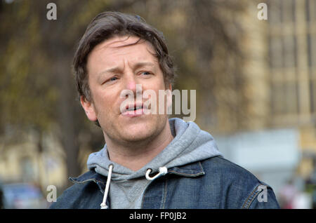 London, UK, 16 March 2016 Jamie Oliver celebrates the sugar levy on Parson' Green opposite the houses of Parliament - Stock Photo