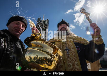 Baikonur, Kazakhstan. 17th Mar, 2016. A Russian Orthodox priest leads prayers and sprays holy water during a blessing - Stock Photo