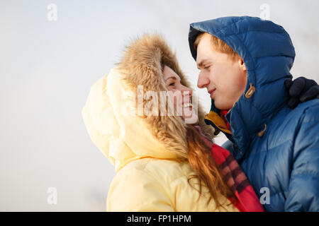 Couple in winter forest - Stock Photo