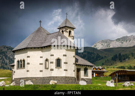 Little church situated in the Dolomites, at Passo San Pellegrino - Stock Photo