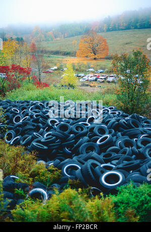 Old used automobile tires in landfill - Stock Photo