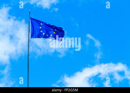 European Union flag flying in the sky - Stock Photo
