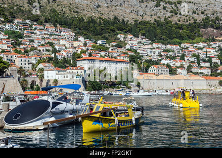 The Old Town Harbour in Dubrovnik city, Croatia. Lazareti and Gymnasium school on the other side - Stock Photo
