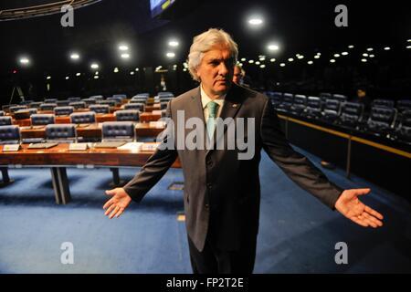 Brazilian Senator Delcidio Amaral reacts to a reporters question as he arrives in the Senate chambers June 3, 2015 - Stock Photo