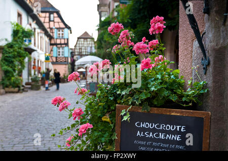 Blackboard menu with flowers for typical Alsace delicacy of Choucroute Alsacienne in Riquewihr France - Stock Photo