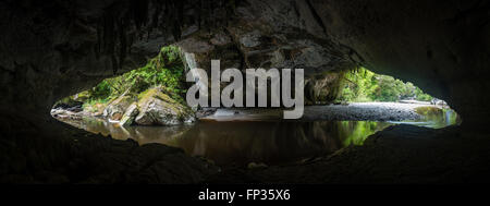 Moria Gate Arch from inside, Oparara river, Westcoast, New Zealand - Stock Photo