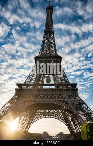 Sunset behind the Eiffel Tower, Champ de Mars, Paris, Ile-de-France, France - Stock Photo