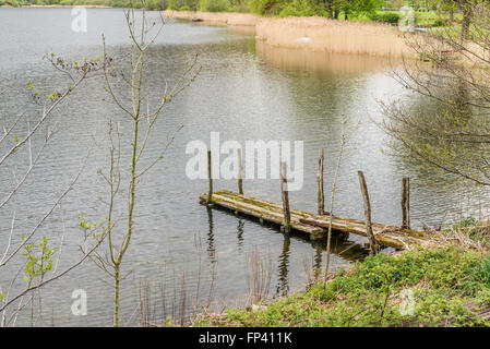 Lake District, United Kingdom - May 09, 2015: Old wooden jetty in Lake District, England, near Grassmere - Stock Photo