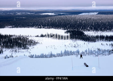 Salla ski resort. Deep in the wilderness of heavily snow laden coniferous trees and rugged fell highland, in the - Stock Photo