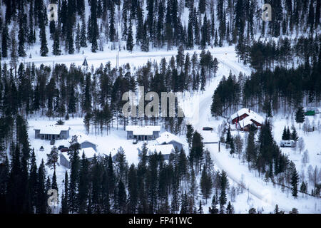 Hotels near the Salla ski resort. Deep in the wilderness of heavily snow laden coniferous trees and rugged fell - Stock Photo