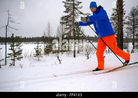 Salla ski resort. Cross-country sky. Deep in the wilderness of heavily snow laden coniferous trees and rugged fell - Stock Photo